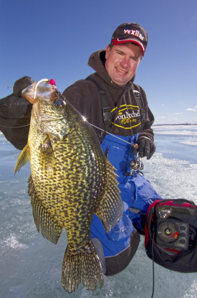The author Jason Mitchell believes that anglers can sometimes target some of the biggest crappie and sunfish by fishing high in the water column right under the ice.